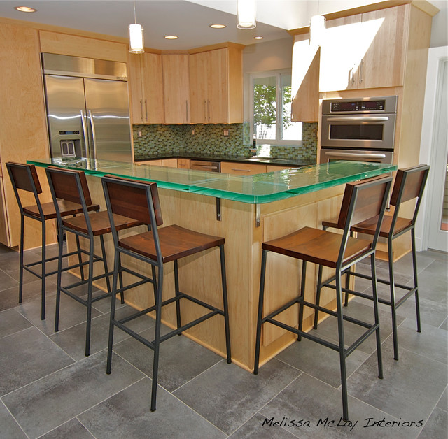 Kitchen with glass counter, grey tile, and maple cabinets ... on Gray Countertops With Maple Cabinets  id=27034
