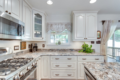 White Cabinets And Travertine Floor