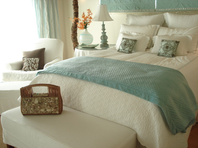 With a colorful or strong choice of curtains framing the bed, the window, the curtains and everything in between become one big and bold visual focal point. Beach House - Beach Style - Bedroom - Los Angeles - by