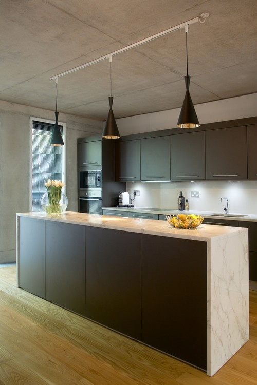 Dark cabinets are both cozy and contemporary,