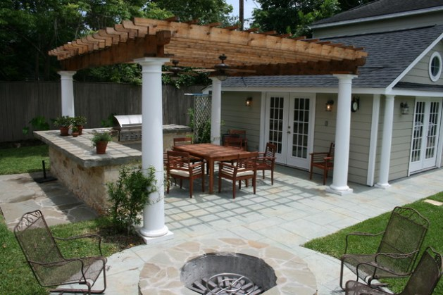 Outdoor Kitchens Example of a classic backyard patio design in Houston with a fire pit and a  pergola
