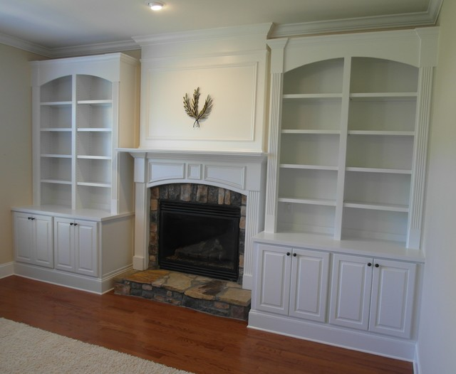 Fireplace Built-ins With Divided Arched Bookcase