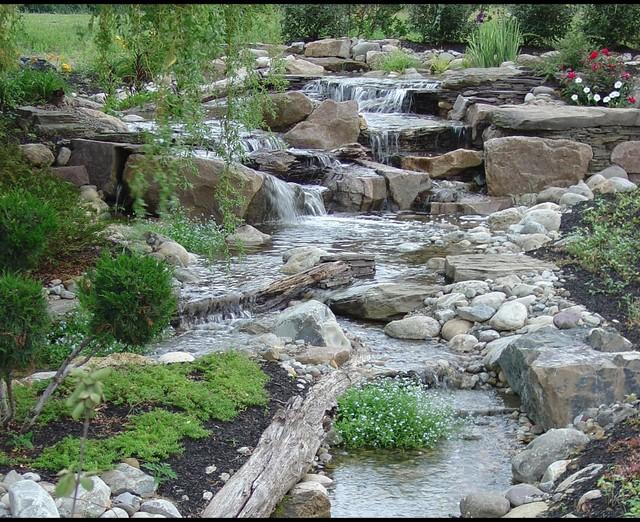 Pondless Waterfalls, Disappearing Waterfalls, Low ... on Backyard Stream Ideas id=53294