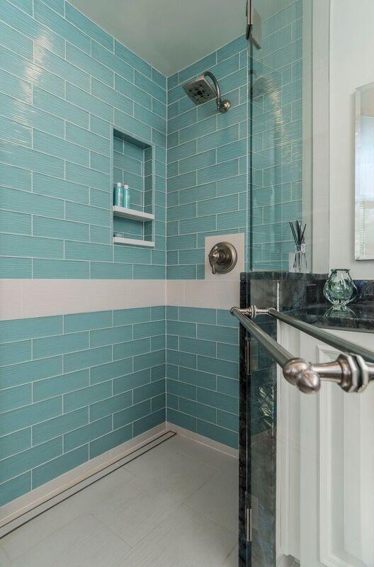 teal glass master bathroom