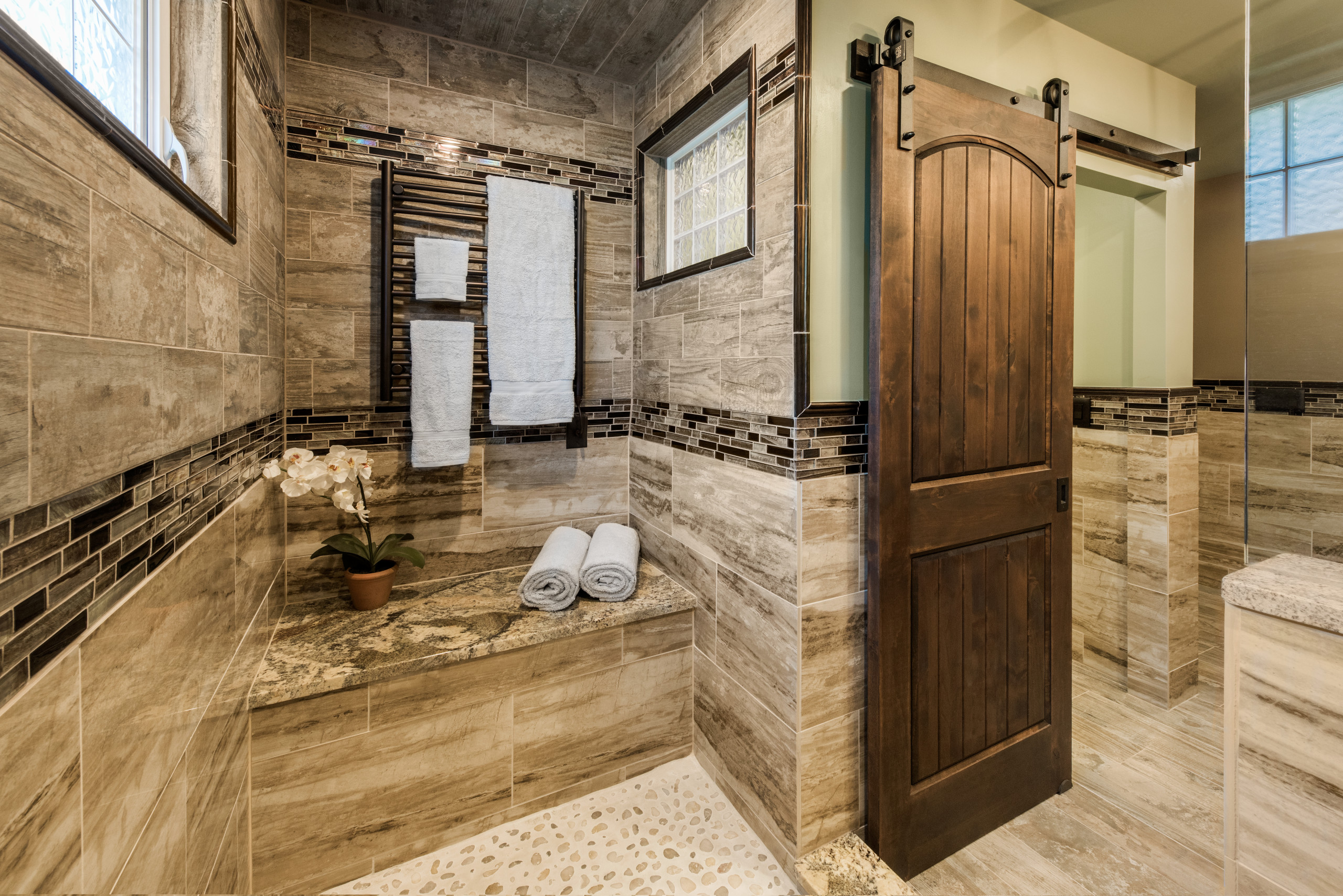 brown tile bathroom with green walls