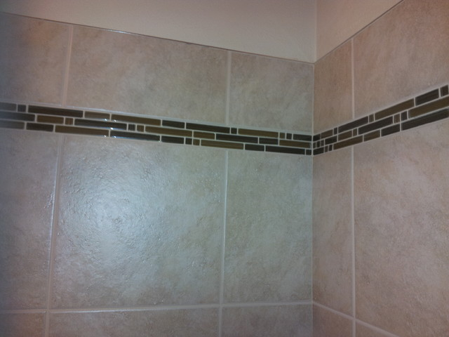 shower accent tile with metal edging
