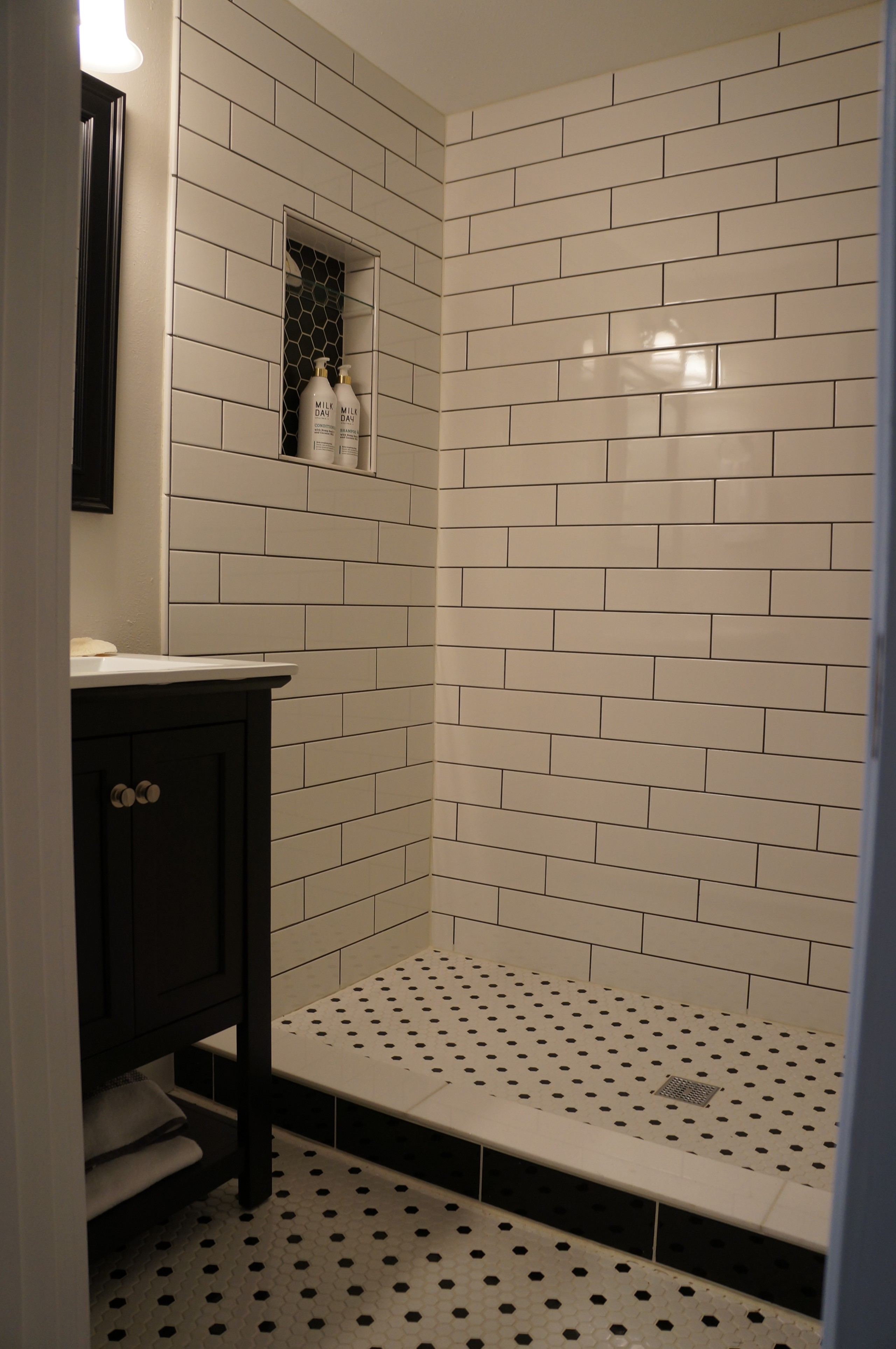shower curtain with black cabinets