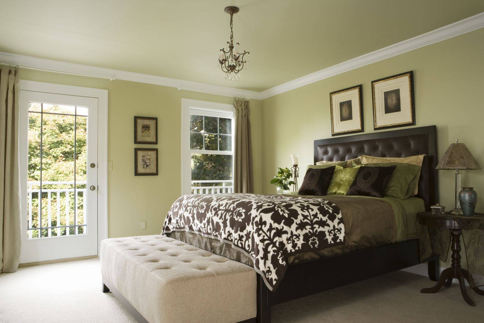 master bedroom with tufted headboard