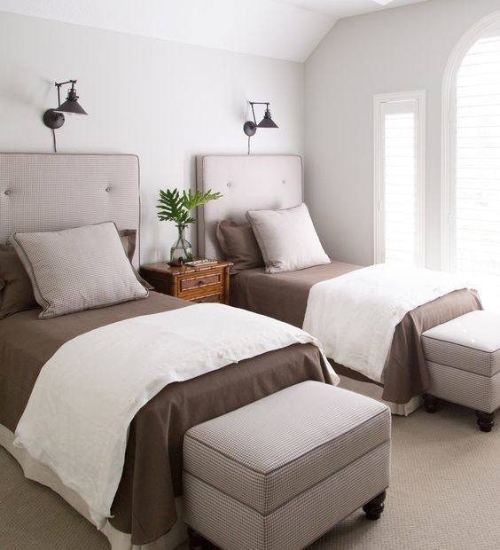 twin bedroom with dark brown bed sheets