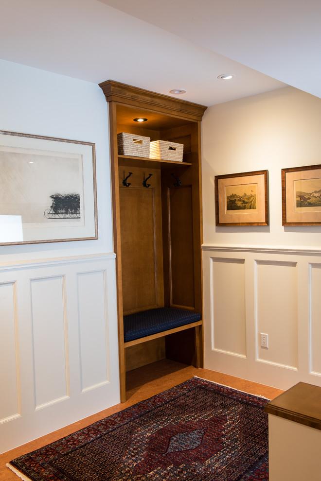 white wall paneling built in coat rack