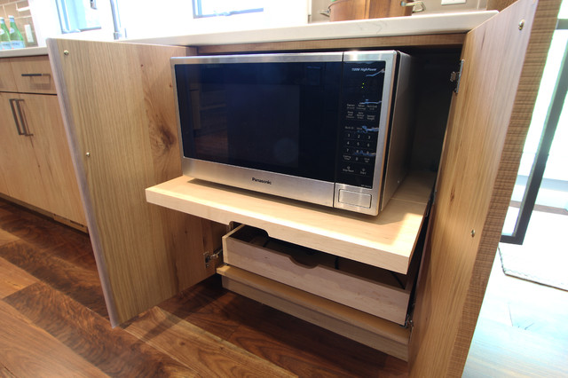 hidden microwave on pullout shelf with