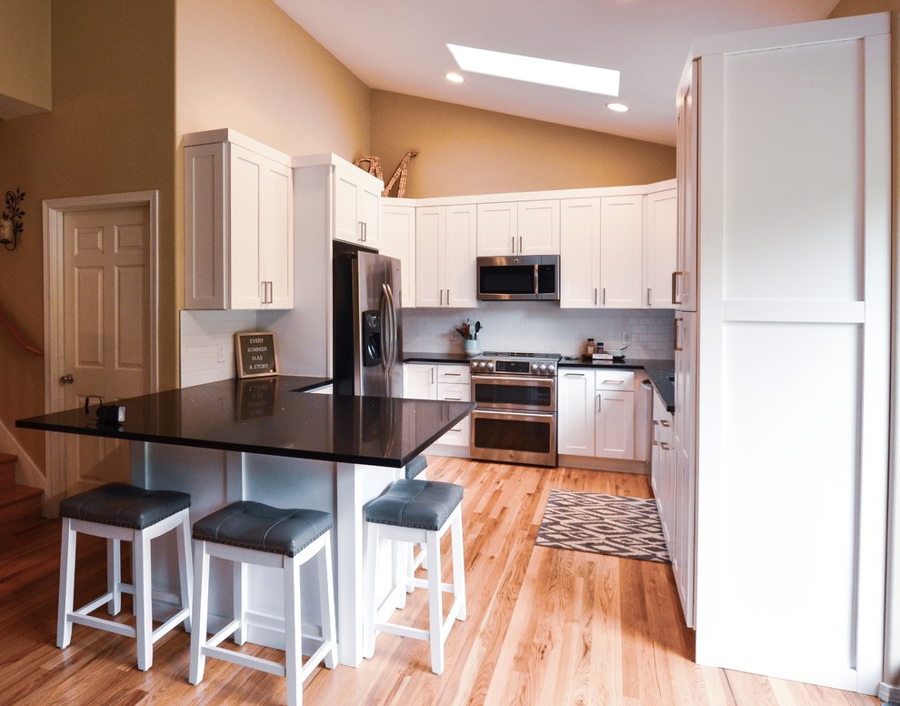Traditional White Kitchen, Galaxy Granite Countertops ... on Light Maple Cabinets With White Countertops  id=40929