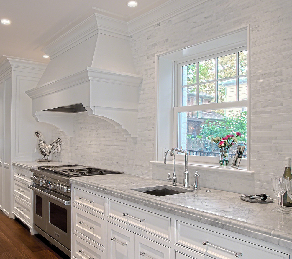 White Stone Backsplash - Transitional - Kitchen - Chicago ... on Backsplash Ideas For White Cabinets And Granite Countertops  id=68670
