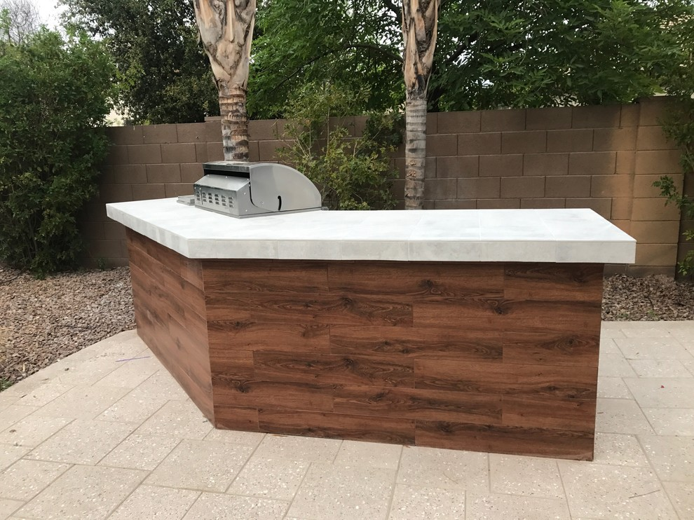 modern bbq island with stainless grill