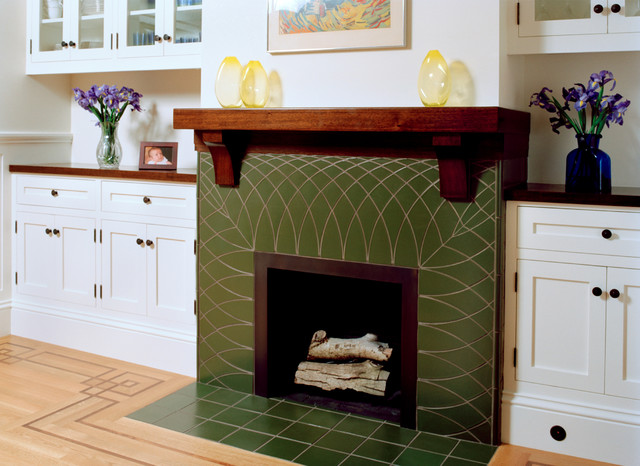 green tile fireplace with wood mantel