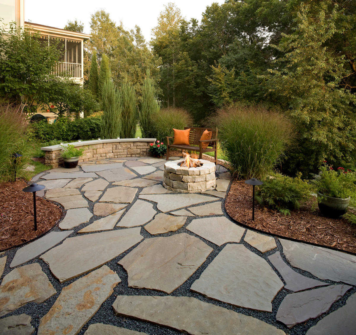 flagstone patio and natural stone fire