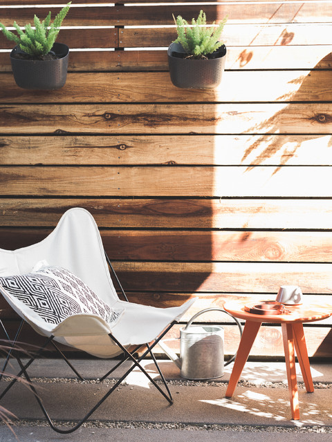 outdoor patio with butterfly chair and