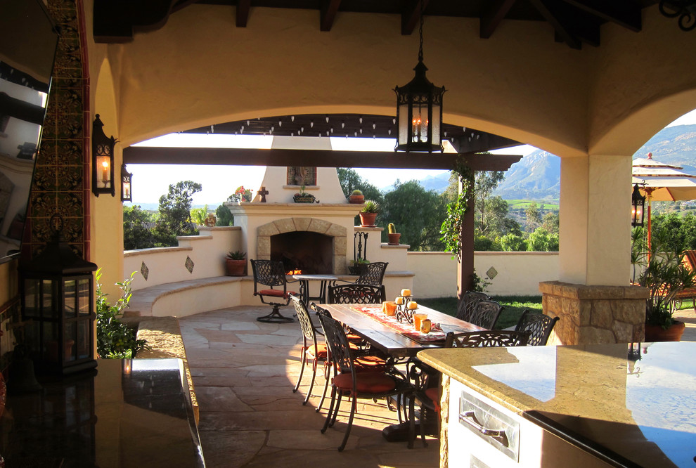 Spanish Style Covered Outdoor Dining with fireplace in ... on Houzz Backyard Patios  id=65259