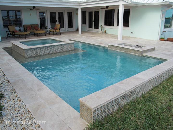 ivory tumbled travertine pool deck