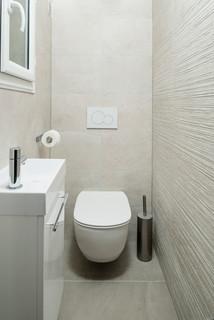 wc et toilettes avec un mur beige