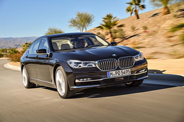 2017 BMW M760i xDrive V12 Excellence front three quarter in motion 13