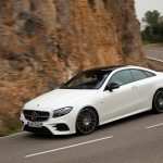 2018 Mercedes Benz E400 coupe front three quarter in motion 06 1