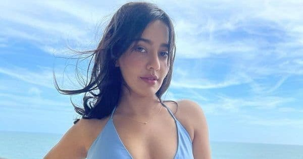 Neha Sharma sets the temperature soaring in a blue bodycon dress with a thigh-high slit and a plunging neckline