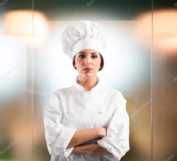 Женщина шеф-повар в шляпе и фартуке — Стоковое фото ...