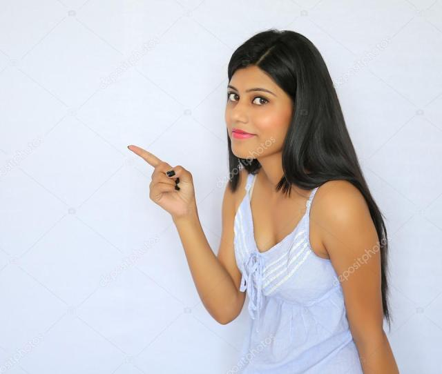 A Young Sexy Indian Girl Pointing Her Finger Isolated On A White Background Photo By Redshinestudio