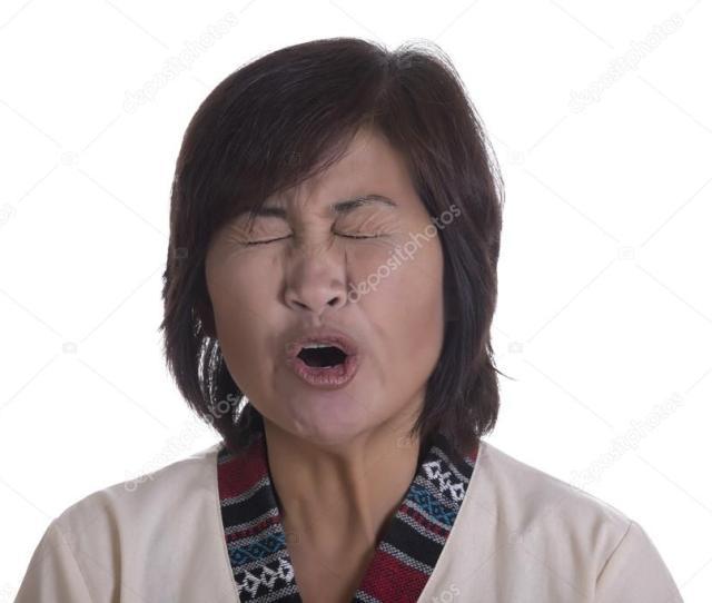Mature Asian Woman Yawning Or Yelling Stock Photo