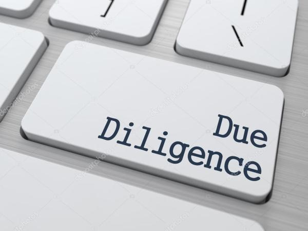 Due Diligence on Keyboard Button Stock Photo