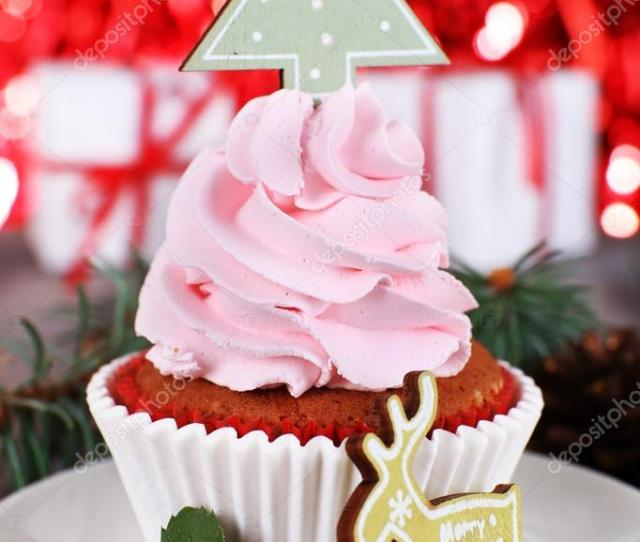 Cup Cake With Cream On Saucer And Christmas Decoration On Wooden Table And Shine Brightly Background Photo By Belchonock