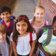 stock-photo-smiling-little-school-kids-in