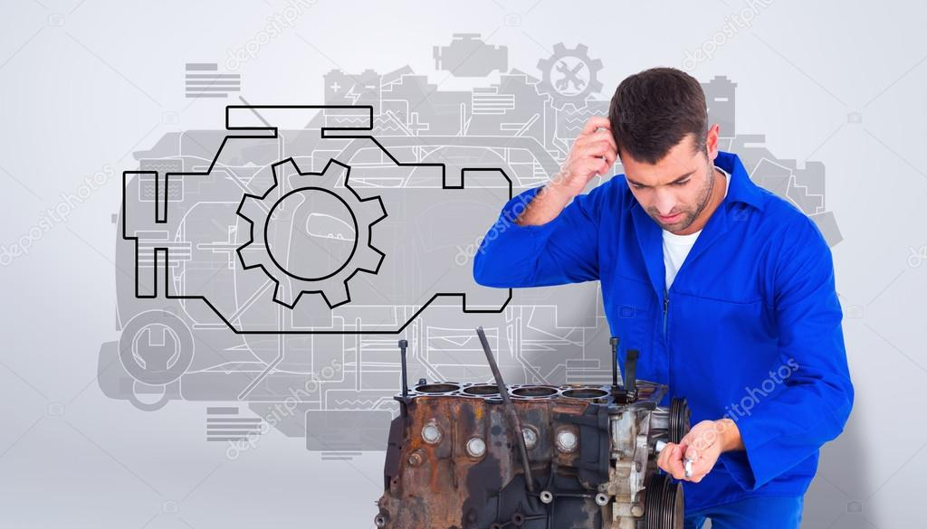 Confused Mechanic Repairing Car Engine Stock Photo Wavebreakmedia 76142911
