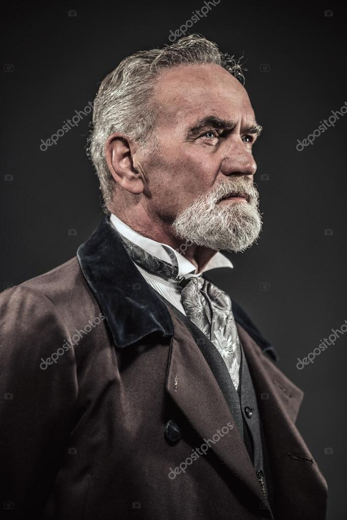 Vintage Characteristic Senior Man With Gray Hair And Beard