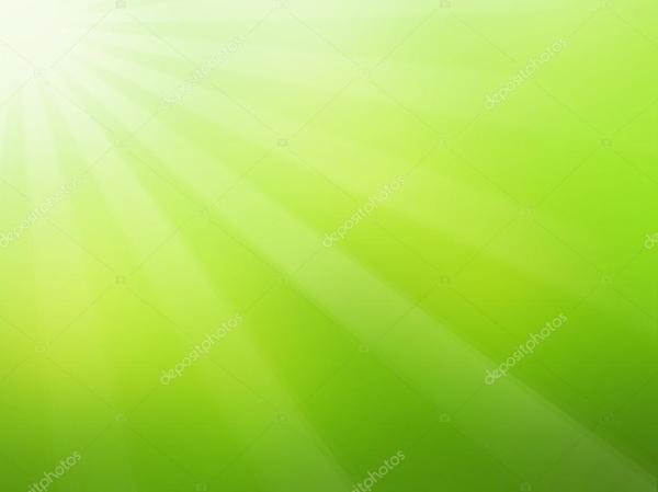 Fond vert printemps avec les rayons du soleil ...