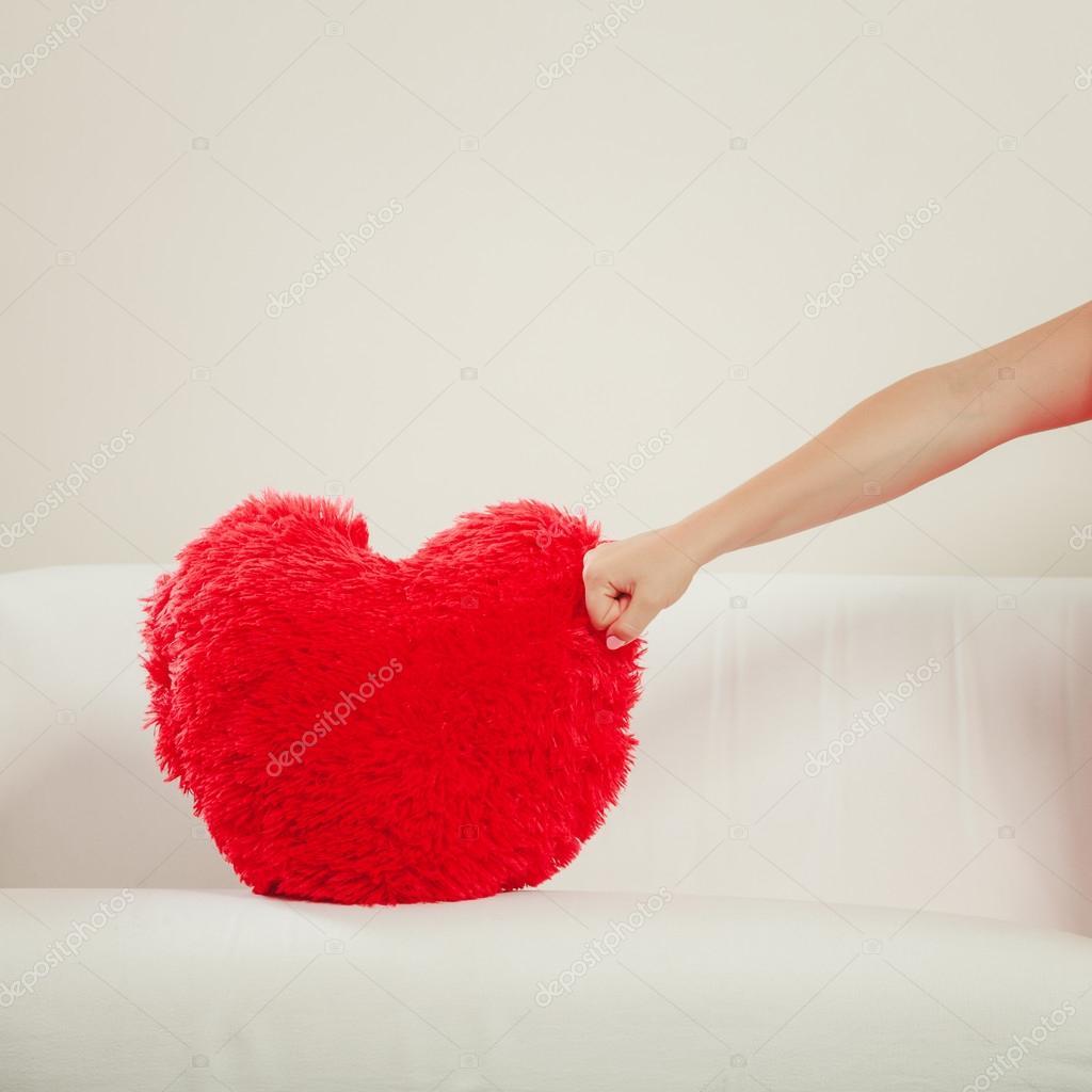 https depositphotos com 98001868 stock photo hand punching red heart pillow html