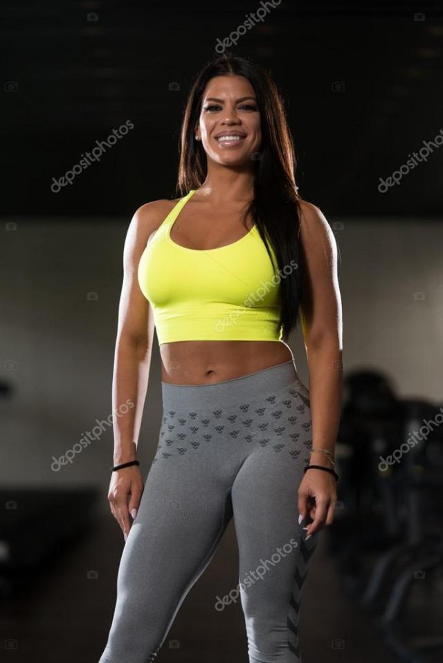 Gorgeous Latina Woman Posing In The Gym Stock Photo