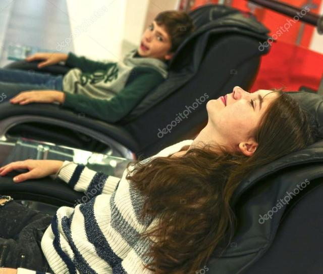 Teen Siblings Brother And Sister In Massage Chair Stock Photo