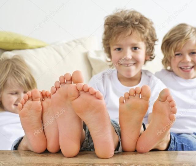 Boys Feet On The Table Stock Photo