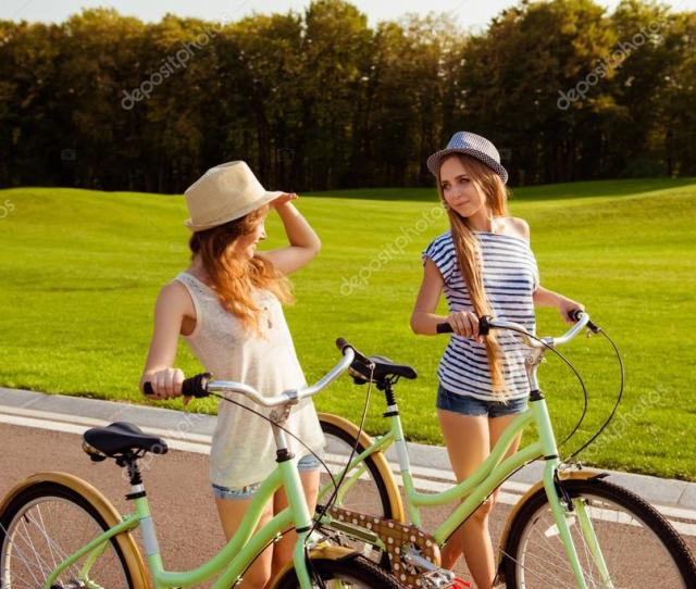 Cute Lesbians With A Hats Walking With A Bicycle On Park Photo By Deagreez