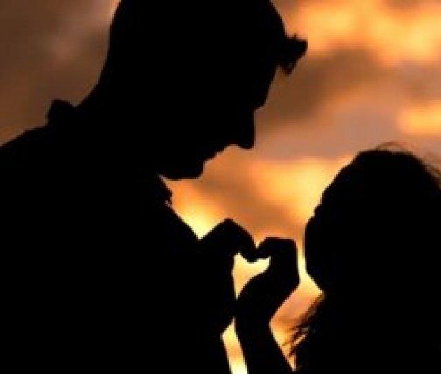 Romantic Couple Making A Heart Shape Silhouette Stock Video