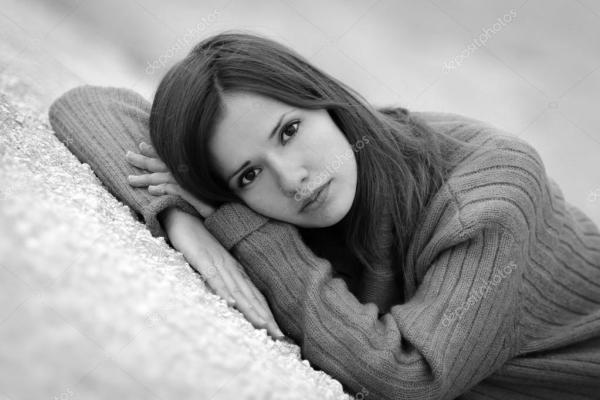 Unhappy girl with deep dark eyes look at the camera.Sad ...