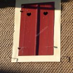 Decorative Red Wooden Shutters And Wooden Tiled Wall In