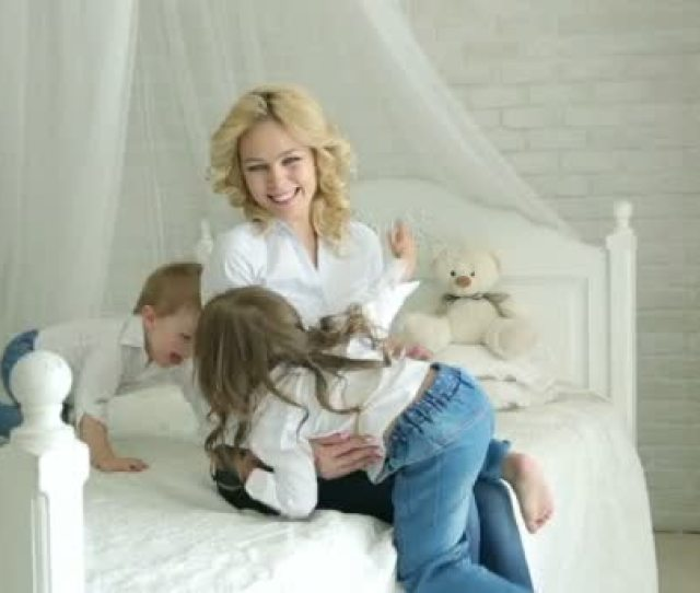 Children Little Boy And Little Girl Hug And Kiss Mom Happy Family Mom