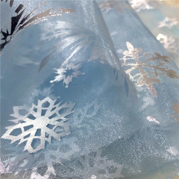 Tulle with snowflakes photo