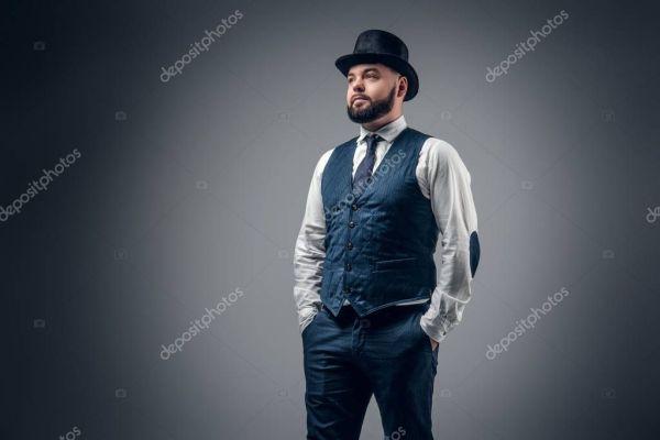 Мужчина в цилиндре. Бородатый мужчина в жилет и цилиндр ...