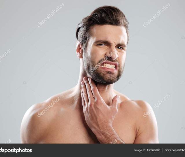 Young Handsome Naked Man Expertising His Fce Before Shaving Stock Photo