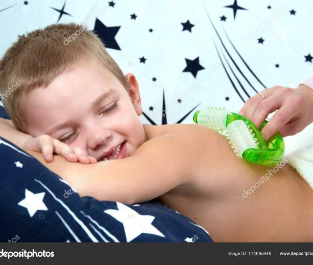 The Mother Makes The Massage Of The Back Of His Little Son Stock Photo