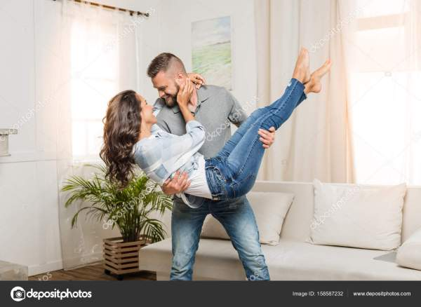 man holding woman in his arms — Stock Photo ...